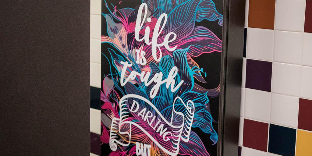 Header image for the article Bathroom stall art raises mental health awareness